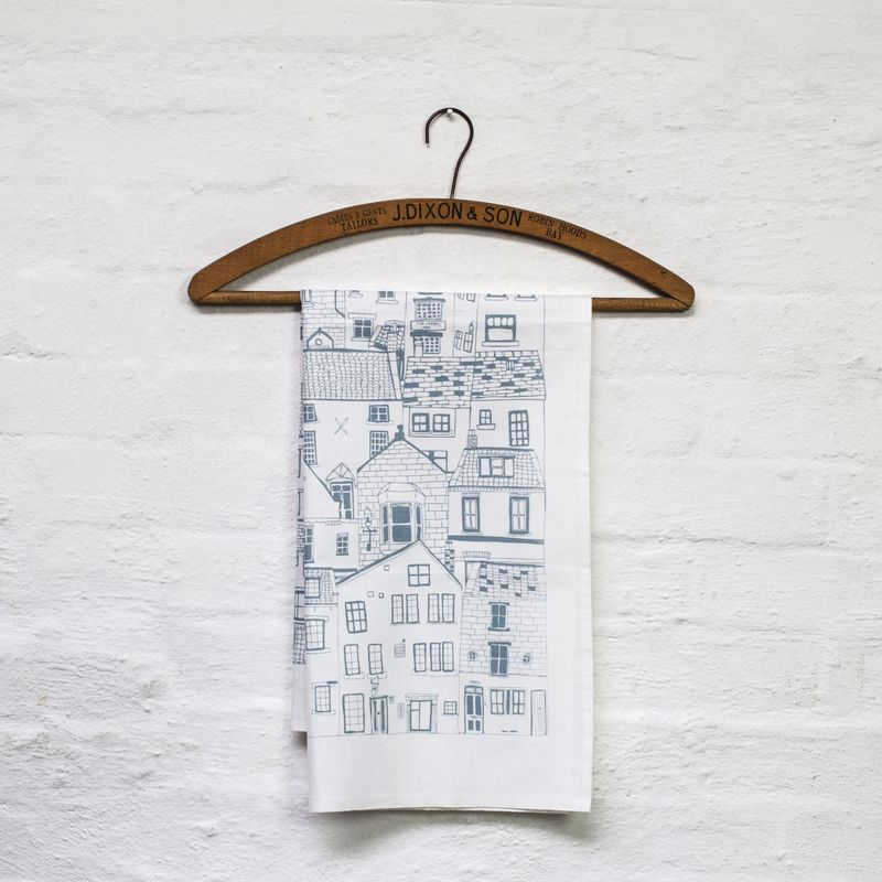 Jess Hogarth-Coastal Cottages tea towel  - grey on coathanger